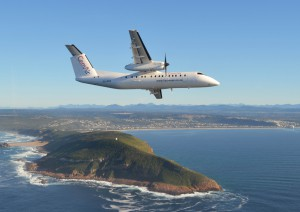 CemAir Bombardier Dash 8 Q300 over Robberg, Plettenberg Bay. CemAir leases aircraft and operates an airline