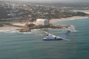 CemAir Bombardier Dash 8 100 over Beacon Isle, Plettenberg Bay. CemAir leases aircraft and operates an airline