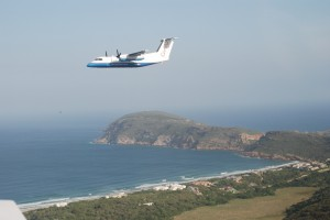 CemAir Bombardier Dash 8 100 over Robberg, Plettenberg Bay. CemAir leases aircraft and operates an airline