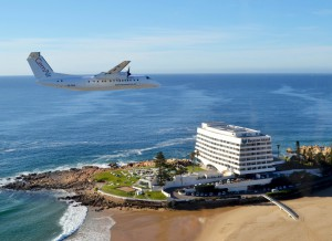 CemAir Bombardier Dash 8 Q300 over Beacon Isle, Plettenberg Bay. CemAir leases aircraft and operates an airline